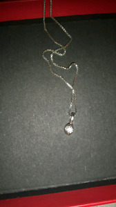 Canadian diamond earrings and necklace
