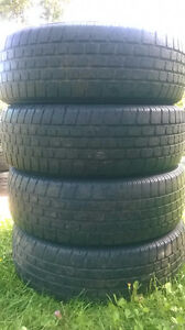 Two Wild Country TXI 215 70 16 all season tires.