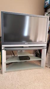 """Sony 42"""" Wega rear projection TV with Sony stand."""