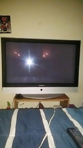 """42"""" Plasma Display with HDMI cord and mount connected to TV"""