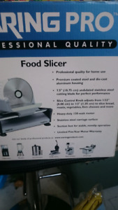 Like new professional food slicer used once clean in the box