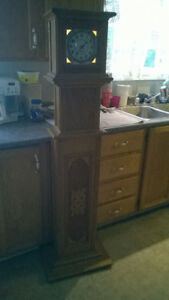antiquie  stand up clock   for sale