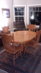 Oak pedestal table with 4 high back chairs