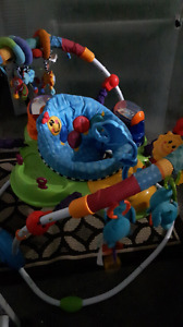 Baby jumper with music and toys