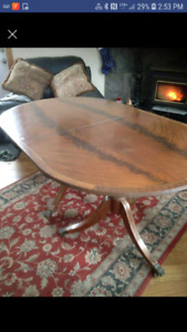 Brass inlaid oval table