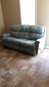 Double sided recliner couch