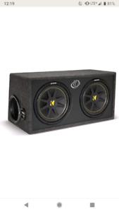 """dual 10"""" kicker subs in ported box"""