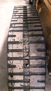 Loegering track system for skid steer