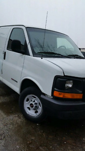 White GMC Savana