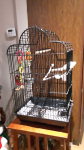 Large bird cage for sale.