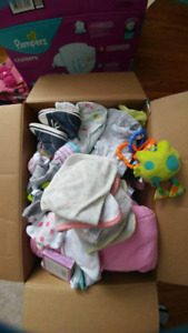 Box of baby clothes and receiving blankets snow suit