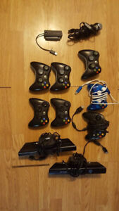 xbox360 controllers 1 green 1 white and 4 black ones and 2 wired
