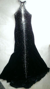 Never worn low cut halter evening gown in size 6