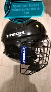 two junior hockey helmets. size M. great condition.