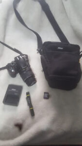 Nikon D3200 With lens + travel bag