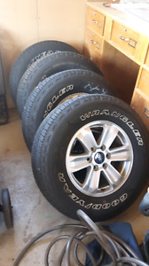 Like new ford f150 rims and tires!! 265/70R/17