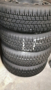 185/65R15 SET 4 ALL SEASON TIRES 90% TREAD ON TOYOTA RIMS