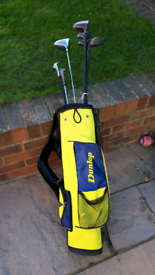 Junior golf bag and clubs x 7