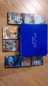 PS2 Play Station 2 fonctionnelle avec 8 jeux.