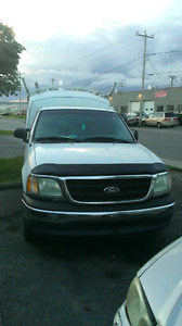 $$$Ford f150 xl with spacekap box and Aluminum ladder rack$$$