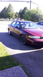 Burgundy Buick Century. $2000. Very reliable car. Never had a pr