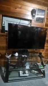 "55"" LED TV, glass tv stand and a sound bar"