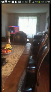 Antique dining table with 5 chairs
