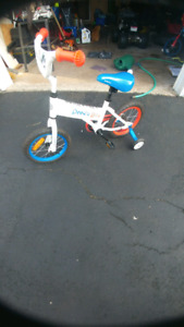 ONLY USED A COUPLE OF TIMES. KIDS BIKE WITH TRAINING WHEELS