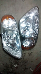 02 Dodge Caravan headlight L & R, good condition, both $100.00