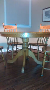 Solid oak table and 8 chairs London Ontario image 1