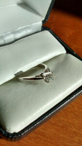 Lady's gold and platinum solitaire engagement ring, and band.