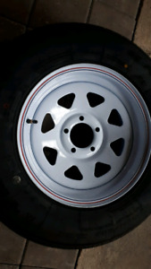 NEW TRAILER TIRE AND WHEEL