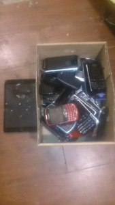Box of Blackberry and other touch screen cel phones