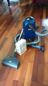 Miele delux vacuum cleaner with attachments