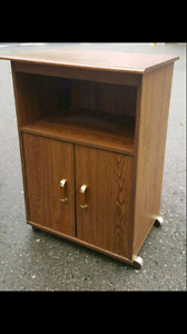 Microwave stand brown colour.