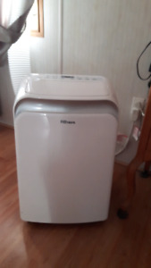 2 stand up air conditioning units 1 year old