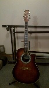 Ovation Acoustic guitar and hard case.