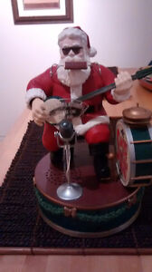 Animated Santa playing drums and singing activated by voice