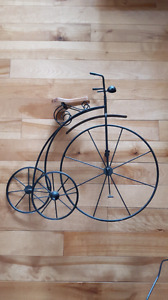 Wrought iron tricycle wall art