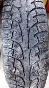 Studded winter tires on rims for full size pick-up