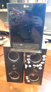 LG stereo system with 2 speakers, cd player, ipod dock, aux jack