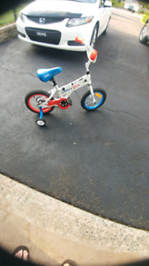 Hardly used kept inside kids bike with training wheels