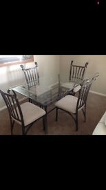 Glass dining table and four chairs