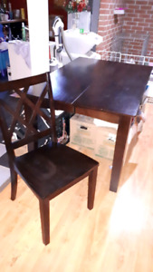 Table with butterfly leaf and 4 (to 8) chairs