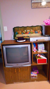 Wood TV stand with a TV and VCR included
