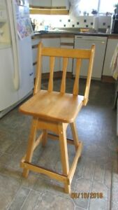 Swivel high chair for child.