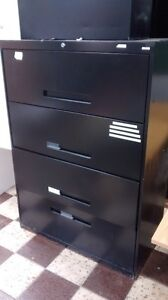 Four Drawer Black Metal Filing Cabinet.