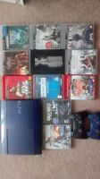 500G PS3 Slim NHL Edition. +11 Games & 2 Controllers. 120 FIRM