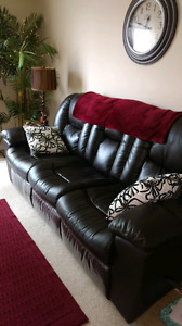 Leather couch with two reclining ends