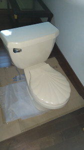 Good condition, American standard toilet clamshell lid